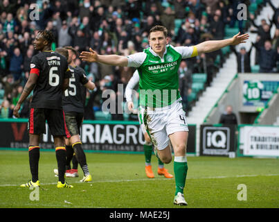 Edinburgh, UK, 31 Mar 2018.  Pic shows:  Hibs defender, Paul Hanlon, celebrates after scoring his side's second goal during the second half of the Scottish Premiereship clash between Hibernian and Partick Thistle at Easter Road Stadium, Edinburgh.  Credit: Alamy/Ian Jacobs - Stock Photo