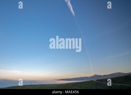 Long exposure showing the SpaceX Falcon 9 rocket carrying the Iridium-5 satellite blasting off from Vandenberg Air Force Base March March 30, 2018 in Vandenberg, California. Credit: Planetpix/Alamy Live News - Stock Photo