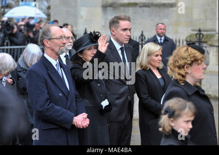 Cambridge, Britain. 31st Mar, 2018. British physicist Stephen Hawking's first wife Jane (2nd L, front) waves while attending the private funeral of Stephen Hawking at the Great St Mary's Church in Cambridge, Britain, on March 31, 2018. The funeral of Professor Stephen Hawking was held Saturday at a church near the Cambridge University college where he was a fellow for more than half a century. Credit: Stephen Chung/Xinhua/Alamy Live News - Stock Photo