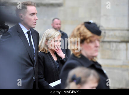 Cambridge, Britain. 31st Mar, 2018. British physicist Stephen Hawking's son Timothy (1st L) and daughter Lucy (2nd L) attend the private funeral of Stephen Hawking at the Great St Mary's Church in Cambridge, Britain, on March 31, 2018. The funeral of Professor Stephen Hawking was held Saturday at a church near the Cambridge University college where he was a fellow for more than half a century. Credit: Stephen Chung/Xinhua/Alamy Live News - Stock Photo