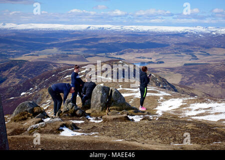 Perthshire, UK. 1st Apr, 2018. UK Weather: Walkers having a well earned rest at the summit of Ben Vrackie. Credit: PictureScotland/Alamy Live News - Stock Photo