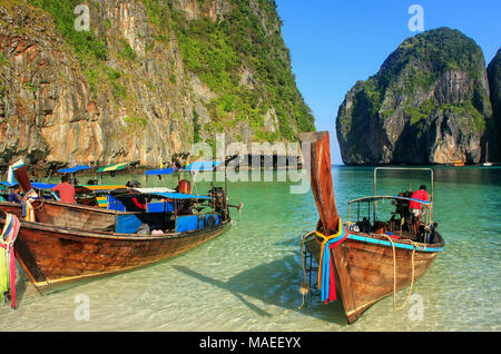 Longtail boats anchored at Maya Bay on Phi Phi Leh Island, Krabi Province, Thailand. It is part of Mu Ko Phi Phi National Park. - Stock Photo