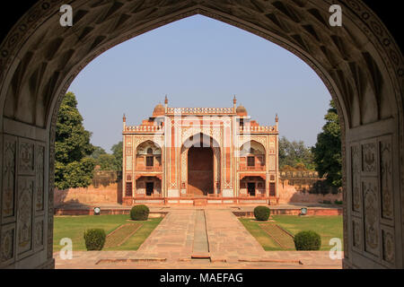 Entrance gate seen from interior of Itimad-ud-Daulah Mausoleum in Agra, Uttar Pradesh, India. This Tomb is often regarded as a draft of the Taj Mahal. - Stock Photo