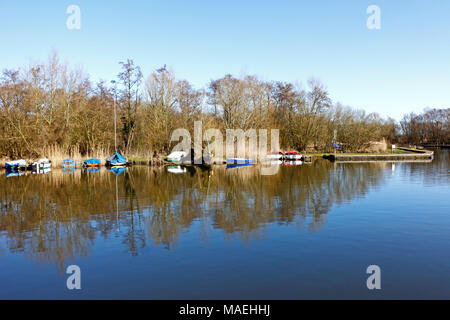 A view of Pennygate Staithe on the Norfolk Broads at Barton Turf, Norfolk, England, United Kingdom, Europe. - Stock Photo