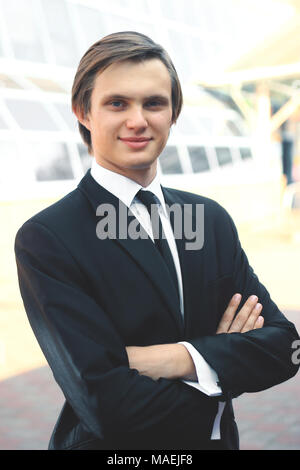 portrait of a young businessman on blurred background - Stock Photo