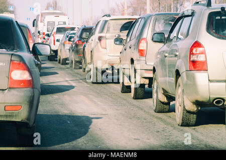 Cars standing in a traffic jam on city street - Stock Photo