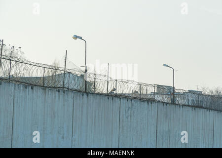 Fence with barbed wire, place of detention - Stock Photo