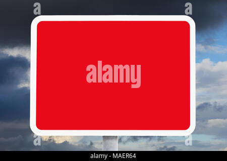 Blank or empty red and white british road sign in front of dark clouds, indicating a safety hazard, risk, danger, background template - Stock Photo