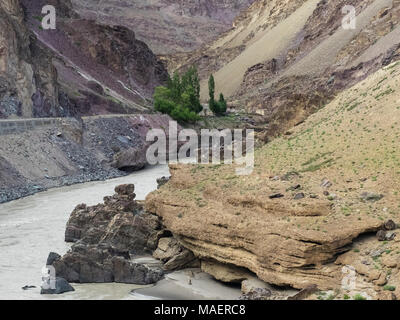 Mountain river flowing along the narrow gorge, one side of the burgundy valley, the second slope of yellow color. - Stock Photo