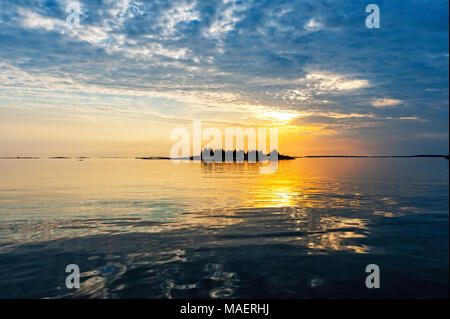 a beautiful sunset on a calm Georgian Bay evening - Stock Photo