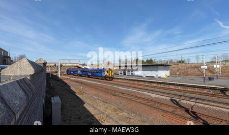 A Scotrail class 156 sprinter train calling at  Carstairs junction station, Scotland on the west coast main line - Stock Photo