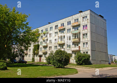 Old Grey Soviet apartment buildings in the former military base of Karosta, Liepaja, Latvia on a sunny day with blue sky. - Stock Photo
