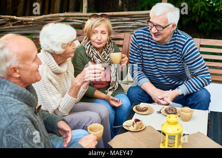 Senior Friends in Cafe - Stock Photo