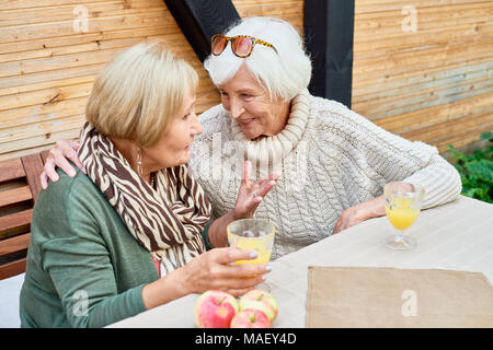 Senior Girlfriends in Cafe Together - Stock Photo