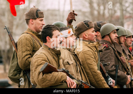 Gomel, Belarus - November 26, 2016: Soldiers of the Soviet Red Army in the ranks after the battle. Reconstruction of the liberation of the city of Gom - Stock Photo