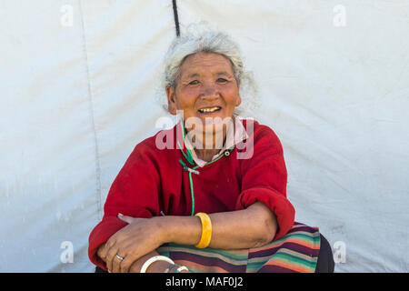 Tibetan woman in traditional clothing at Horse Race Festival, Litang, western Sichuan, China - Stock Photo