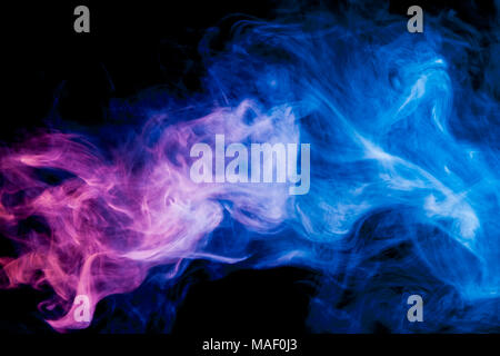 Thick blue   and pink colorful smoke  on a black isolated background. Background from the smoke of vape