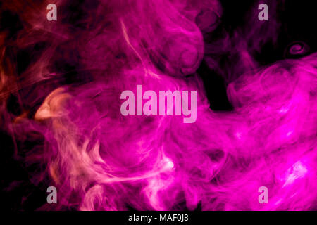 Thick pink  colorful smoke  on a black isolated background. Background from the smoke of vape