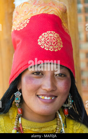 Tibetan woman in traditional clothing, Litang, western Sichuan, China - Stock Photo