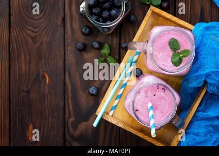 Mason jar mugs with fresh berry cocktails blueberry. Diet, concept of vegetarian food. Proper nutrition. - Stock Photo