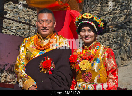 A newly wed couple in traditional Tibetan clothing, Jinchuan County, Sichuan Province, China - Stock Photo