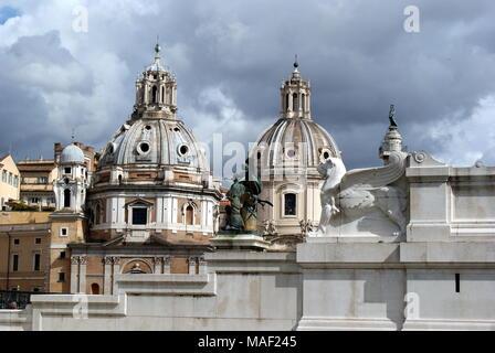 View of Santa Maria di Loreto church domes, Piazza Venezia, Rome, Italy - Stock Photo