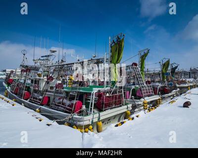 Hokkaido Winter - Squid fishing boats tied up in Hakodate Harbour, Hokkaido, Japan - Stock Photo