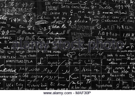 Paris, France - March 20, 2018: The wall of love. Wall in Paris with 'I love you' written in all the major international languages. Black and white. Monochrome. - Stock Photo