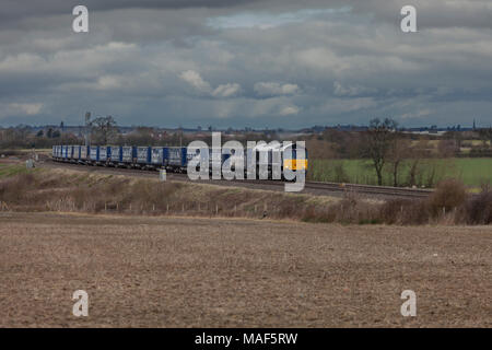 A Direct rail Services class 66 locomotive on The Birmingham to Bristol line with a freight train carrying goods for Eddie Stobart and Tesco - Stock Photo