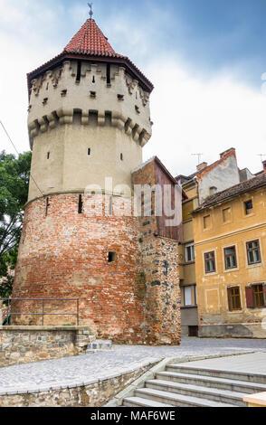 Medieval defense tower Turnul Dulgherilor in Sibiu, Romania - Stock Photo