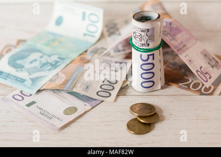 Various Serbian paper money banknotes on wooden table, close up shot - Stock Photo