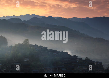 Xijiang Qianhu Miao Village in Guizhou, China at sunrise - Stock Photo