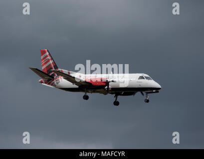 Scottish airline operated by Logan airways Saab34B in its tartan livery arriving at Inverness Dalcross airport. - Stock Photo