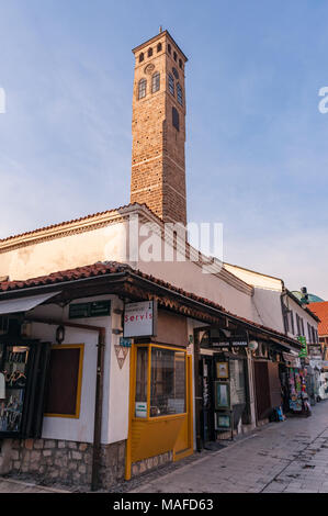 SARAJEVO, BOSNIA - JAN 26, 2018:Sarajevo Old Clock Tower The tower clock is the only public clock in the world that keeps lunar time (a la Turk) to indicate the times for the daily prayers.Located in Ferhadija Street Bascarsija area. - Stock Photo