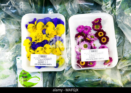 Edible flowers for sale at a supermarket (Morocco) - Stock Photo