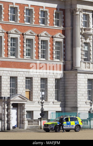 Armed officer outside the Old Admirality Building in London - Stock Photo