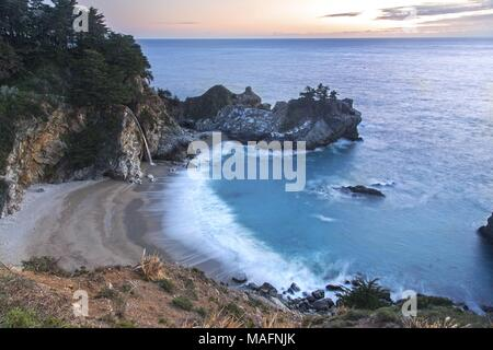 McWay Falls Scenic Waterfall Landscape Sunset View Big Sur Central California Coast Pfeiffer Burns State Park - Stock Photo