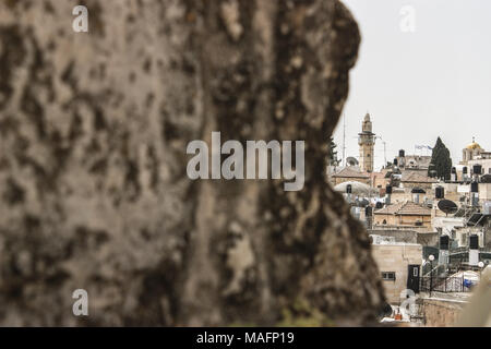 Half hidden view of the city of bethlehem in the occupied palestinian territorys with a piece of wall in the foreground - Stock Photo