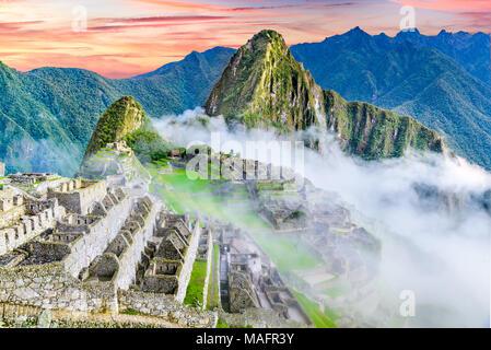 Machu Picchu in Peru - Ruins of Inca Empire city and Huaynapicchu Mountain in Sacred Valley, Cusco, South America. - Stock Photo