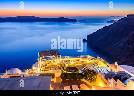 Santorini, Greece. Firostefani twilight, old village in Thira island, Cyclades and Mediterranean Sea. - Stock Photo