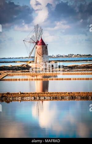 Marsala, Italy. Stagnone Saline Lagoon with vintage windmills and saltwork, Trapani province, Sicily. - Stock Photo