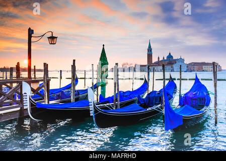 Venice, Italy. Sunrise with Gondolas on Grand Canal, Piazza San Marco, Adriatic Sea. - Stock Photo
