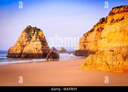 Algarve, Portugal - Praia da Rocha, amazing sunrise at Atlantic Ocean, Portimao. - Stock Photo