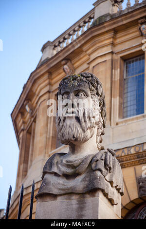 Grotesque roman style bust at the Sheldonian Theatre, Oxford University, Oxford, Oxfordshire, South East England, UK - Stock Photo