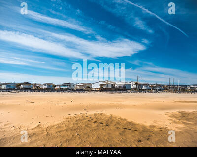 Vacation beach houses in Gruissan on a sunny winter day - Stock Photo