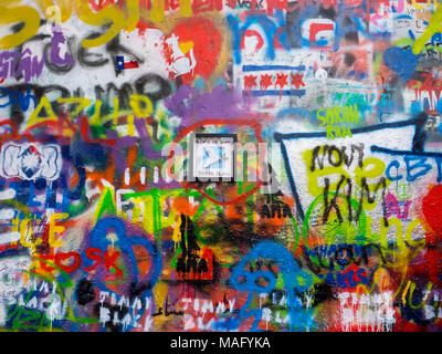 Graffiti and messages of peace on John Lennon tribute colored wall in Prague, Czech Republic - Stock Photo