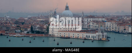 Panoramic view of Venice skyline at dusk on a clear day showing the Basilica di Santa Maria della Salute and Grand Canal. Photo taken from San Giorgio - Stock Photo