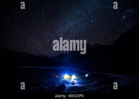 A stunning view of stars and Milky Way galaxy above a campsite near base camp Everest, Nepal - Stock Photo