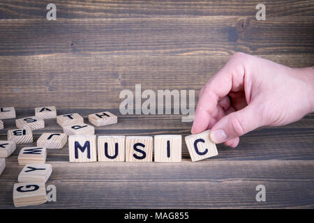 Music. Wooden letters on the office desk - Stock Photo