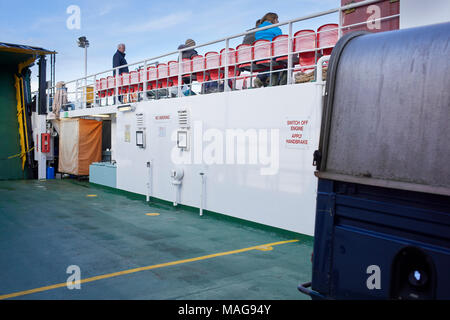 On board Car/Foot ferry from the jetty on Iona to Fionnphort on Mull showing the passenger seating area - Stock Photo